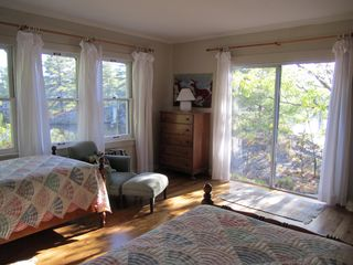 Stoney Lake cottage photo - Master Bedroom in Main Building: lake views (south and west), doors to deck