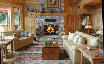 Great Room with Leather Sofas and Fieldstone Fireplace