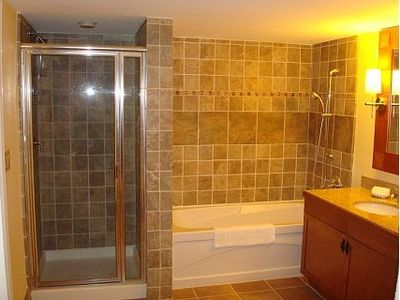Huge bathroom with separate shower and tub