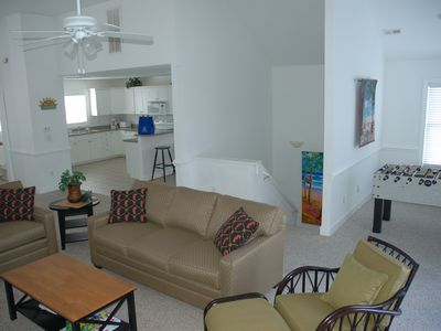 Great room on top floor leads out onto oceanside deck.