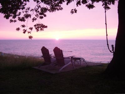 Enjoy sunsets relaxing in the Adirondack chairs.