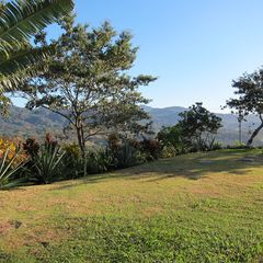 Nosara house photo - Back lawn with views out over the mountains