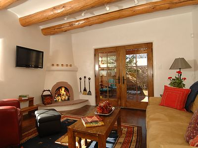 A Charming renovation with all the creature comforts Santa Fe style.
