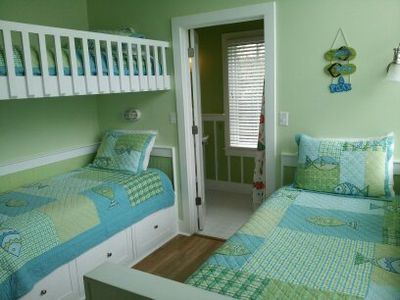 Bunk beds and twin bed in guest bedroom