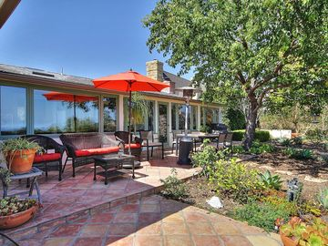Santa Barbara house rental - Patio - A shaded spot for sipping wine under the trees.
