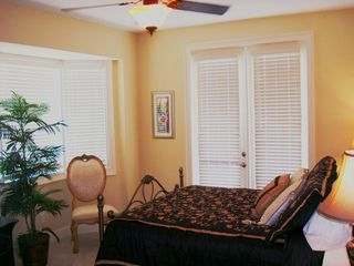 Clearwater Beach townhome photo - Master Bedroom - Queen Bed, Flat screen TV, balcony overlooking Gulf of Mexico