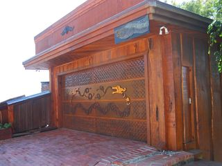 Ventura house photo - Hand carved garage door welcomes you as you approach this gem!