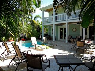 Key West house photo - There are plenty of chaise lounges and seating in the sun & shade out back.