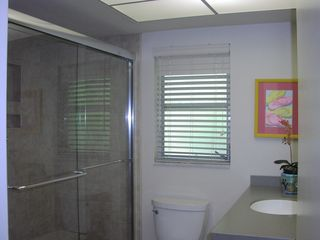 Captiva Island house photo - Renovated full bath with tile shower and glass door.