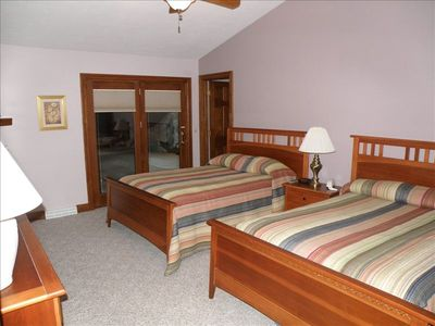 Upper level suite with two full size beds and access to front outside balcony