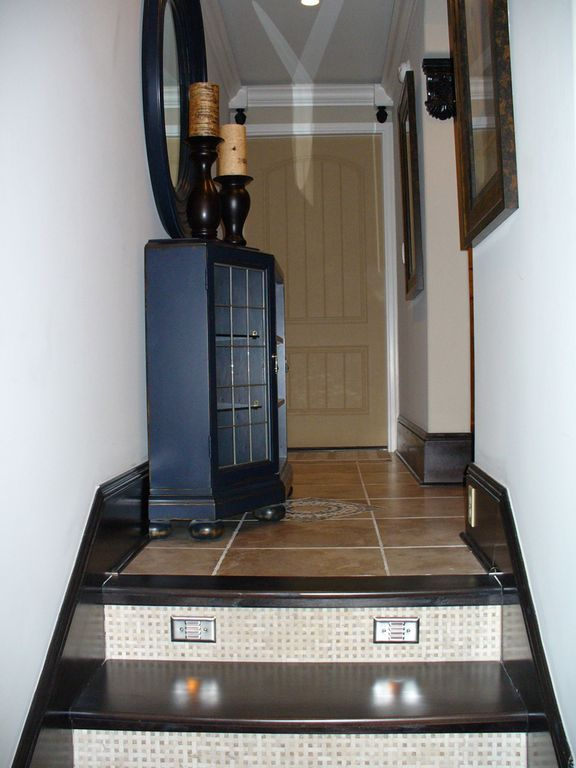 Ceramic tile floor & medallion, stair risers, wood treads, w/ stair lights