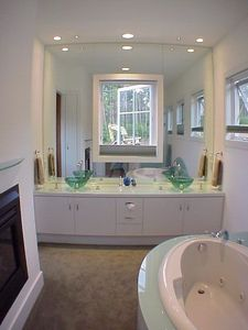 Luxurious master bath with propane fireplace, whirlpool tub and steam shower