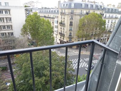 Apartment has two small French balconies.