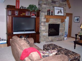 "Sunriver house photo - 60"" TV and gas fireplace provide comfortable entertainment and relaxation"