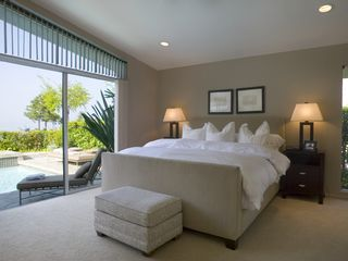 Hollywood estate photo - Tranquil luxurious Master Bedroom - Poolside view