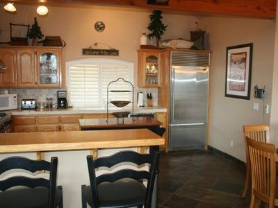 Kitchen with Stainless Steel Viking Appliances and Bar Seating for 4