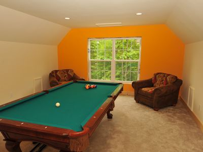Loft with pool table, super comfy armchairs and great view to the back yard.