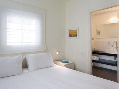 second bedroom with queen size bed, specious bathroom with shower, cable TV,