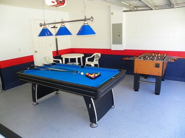 Play pool and foos ball in the games room.