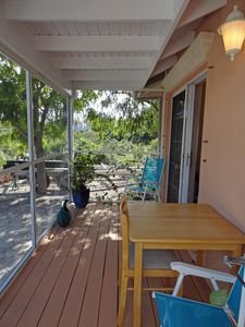 Providenciales - Provo cottage rental - Screened in Porch with Table for dining