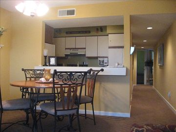 The dining area and kitchen...all cooking/dining utensils and linens included...