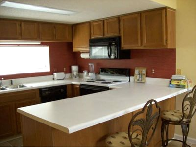 . . .  with a fully equipped kitchen handles service for 8 , , ,