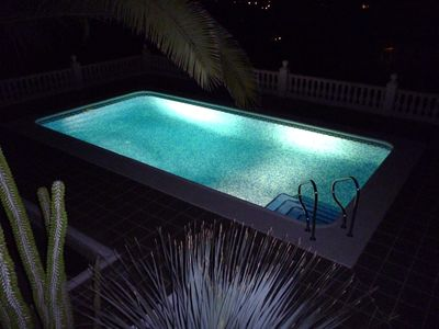 Pool with lights on after dark