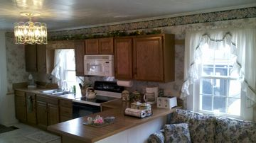 Fully Equipped Kitchen with Sitting Area with Queen Sized Sleeper Sofa