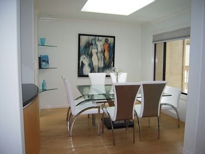 Dining Table seats 8 - perfect for entertaining, white leather chairs & loveseat