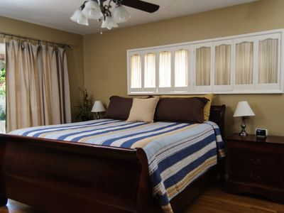 The king size master bed is just steps from the hot tub!