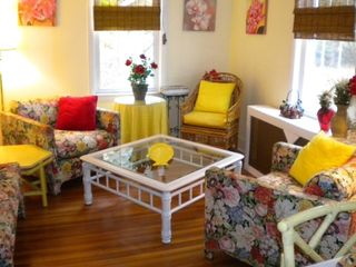 A colorful flower motif and gleaming hardwoods are in the sitting alcove