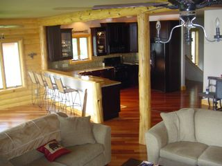 Cedar Lake cabin photo - Granite kitchen counters, breakfast bar, dark cherry cabinets. Dishes furnished.