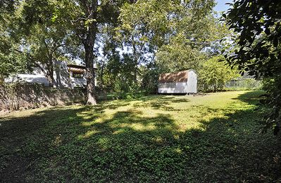 Austin house rental - The large backyard, storage shed in back (not available for guest use)