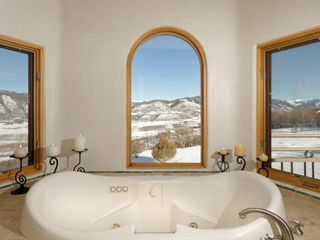 Snowmass house photo - Elegant master bathroom with stunning views