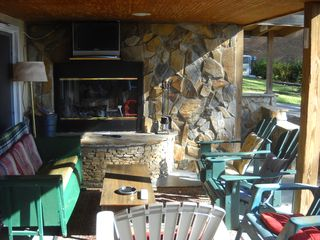 Lexington cottage photo - Outdoor fireplace with TV