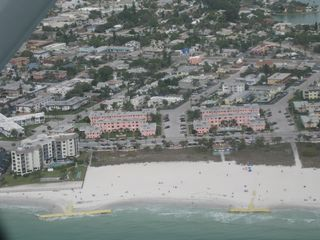 St Pete Beach condo photo - View of Gulf Winds, pink buildings in center, from the air.Units in right bldg.