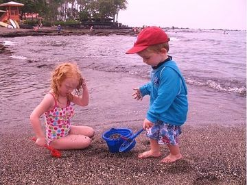 Kids love shallow and gentle Kahalu'u Beach.