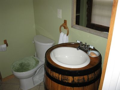Half bath with custom barrel vanity
