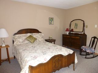Jefferson farmhouse photo - Spacious bedroom furnished with antique furniture on second floor.