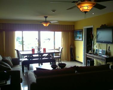 Living room and dining area at balcony terrace with flatscreen HDTV