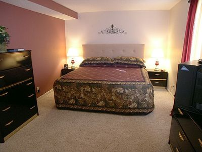 Master bedroom with king size bed, cable TV & walk-in closet
