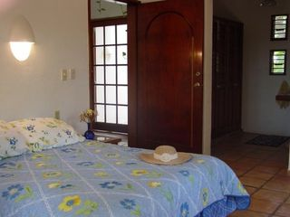 Sunflower Master Suite has queen bed, A/C and garden access. - Playa del Carmen villa vacation rental photo
