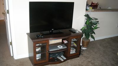 1 of 4 TVs in the house with playstation and games/DVDS/Videos.
