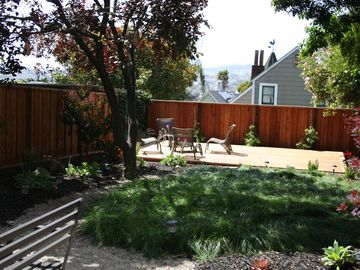 Our fully landscaped back yard with deck at rear that gets all day sun.