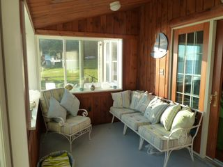 Oneida Lake cottage photo - Enclosed porch over-looks the water.