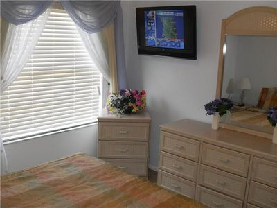 queen bedroom with 32inch lcd tv