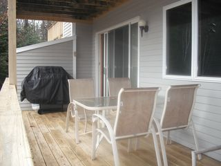 North Conway condo photo - Nice deck with lounge chairs,table and big gas grill.Great view of Mt's off deck