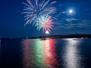 Baddeck house photo - Canada Day Celebration seen from the shore in the village of Baddeck