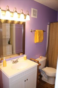 Guest bath with full size washer/dryer.