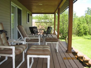 Porch with comfortable seating and two grillls!